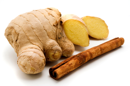 Ginger (Zingiber officinale) and Indonesian Cinnamon quills (Cinnamomum burmannii) on a white background